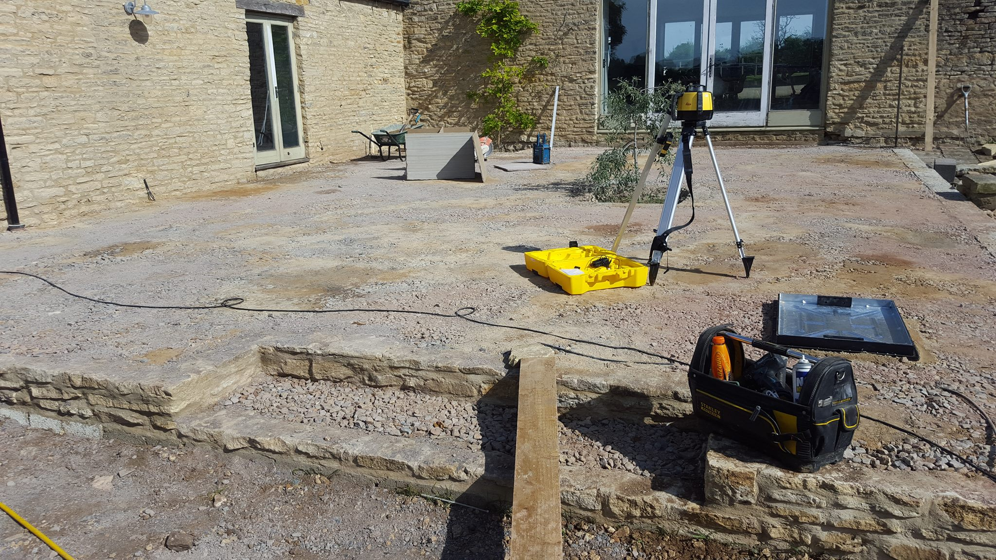 A large sandstone patio area in Duns Tew